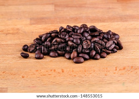 Coffee bean on wooden background - stock photo