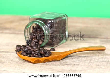 Coffee bean with view of the coffee jar and Herb  jar  - stock photo