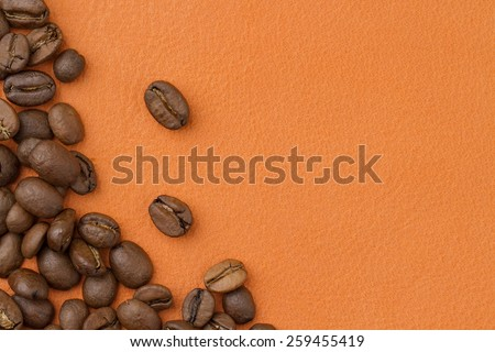 coffee beans an orange background - stock photo