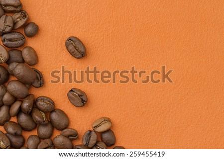 coffee beans an orange background - stock photo