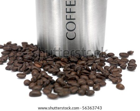 Coffee beans and a canister isolated against a white background - stock photo