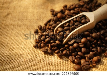 coffee beans and a scoop