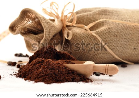 Coffee beans and bag isolated on white background - stock photo