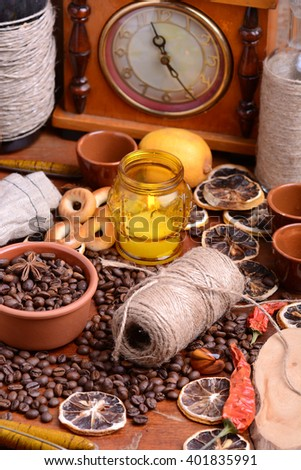 coffee beans and candle. old bottle and vintage clock. lemon and cinnamon. anise and aroma spice - stock photo