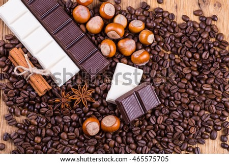 coffee beans and chocolate on a wooden background