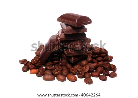 Coffee beans and chocolate pieces - stock photo