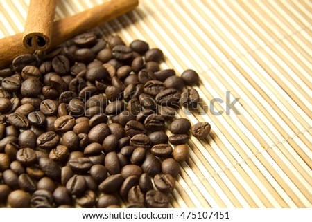 Coffee beans and Cinnamon on Bamboo plank straw mat with copyspace
