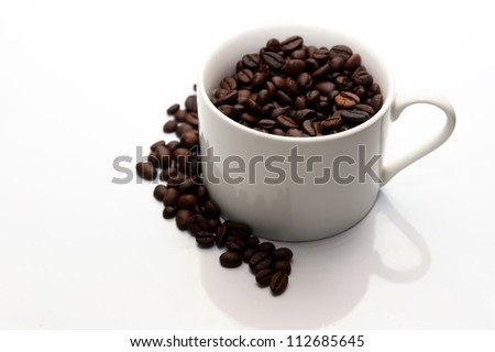 Coffee beans and coffe cup isolated on white background