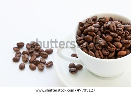 coffee beans and coffee cup on white background