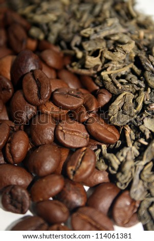 Coffee beans and green tea leaves - stock photo