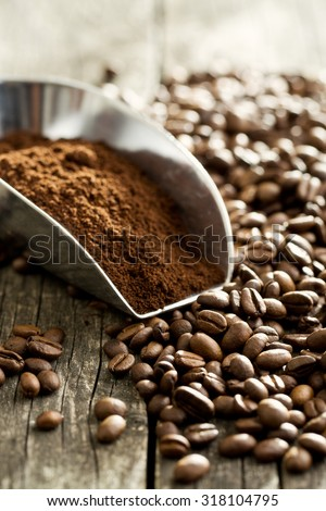 coffee beans and ground coffee in scoop - stock photo