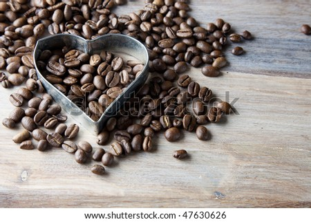 Coffee beans and Heart set on wooden table