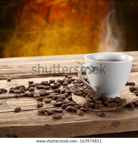 coffee beans and hot drink  - stock photo