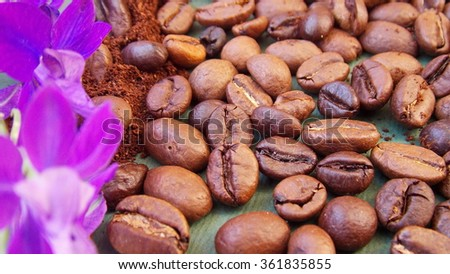 Coffee beans and purple flower