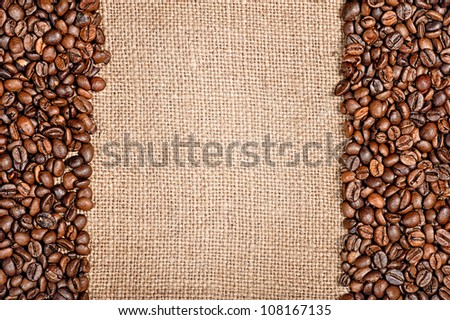 Coffee beans and sackcloth background - stock photo