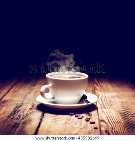 coffee beans and smoke and wooden old desk  - stock photo