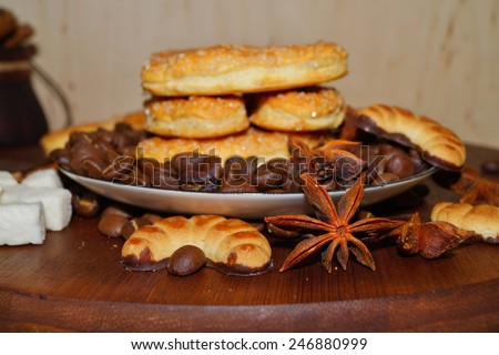 Coffee beans and spices and sugar cookies - stock photo