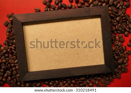 coffee beans and the old photo frame on red paper background
