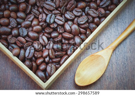 Coffee beans and wooden spoon with filter effect retro vintage style