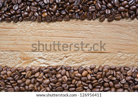 coffee beans background from two different kind of coffee on the old wooden table - stock photo