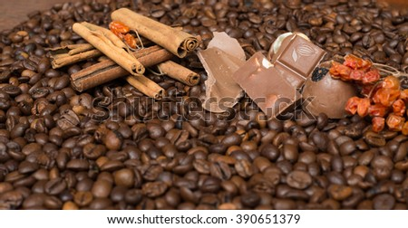 Coffee beans background with  cinnamon, and chocolate