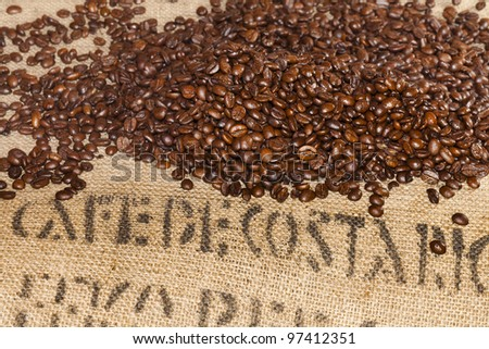 Coffee beans bag with coffee beans - stock photo