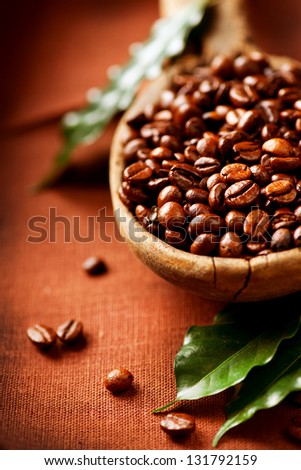 Coffee beans. Bowl of Aromatic Coffee close-up. Coffee Bean and Leaf - stock photo