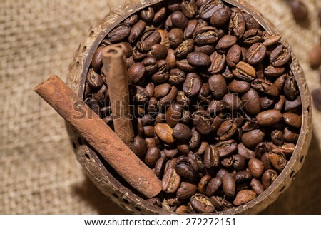 coffee beans, cinnamon, old wooden coffee - stock photo