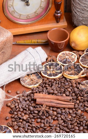 coffee beans, clock, old lemon, cinnamon and aroma spice - stock photo