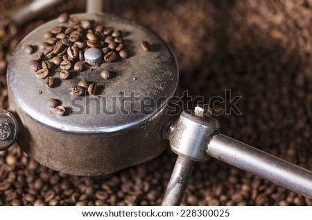 Coffee beans close-up in the coffee roaster - stock photo