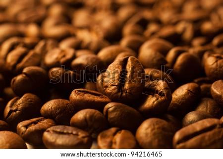 Coffee beans closeup background . - stock photo