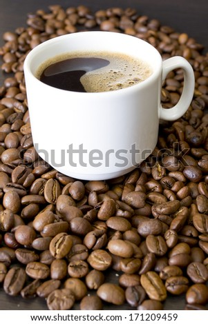 coffee beans, cup, Pots, cinnamon on dark background