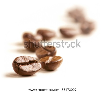 Coffee Beans draw a zigzag line isolated on white. Soft focus. - stock photo