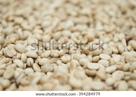 Coffee beans dried in the sun before roast - stock photo