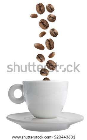 Coffee beans falling in a coffee cup