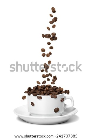 Coffee beans falling in white coffee cup. Highspeed shot - stock photo