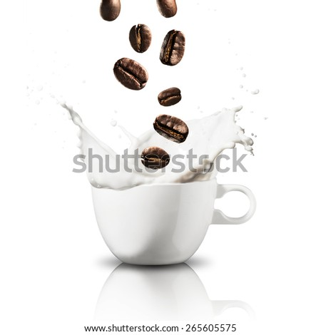 Coffee Beans Falling on Milk Splash - stock photo