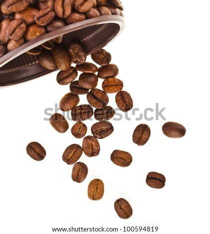 Coffee beans falling on white background - stock photo