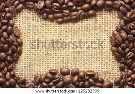coffee beans frame on sacking background