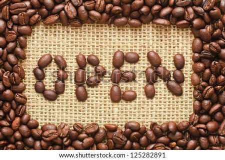 coffee beans frame with open text on sacking background