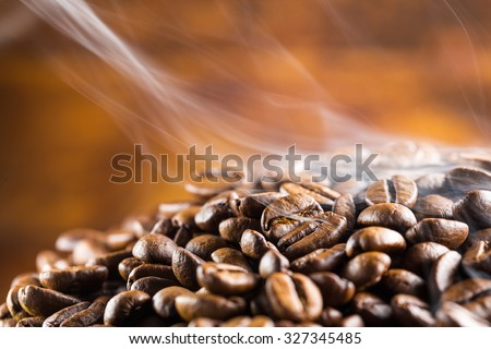 coffee beans fresh roast with smoke - stock photo