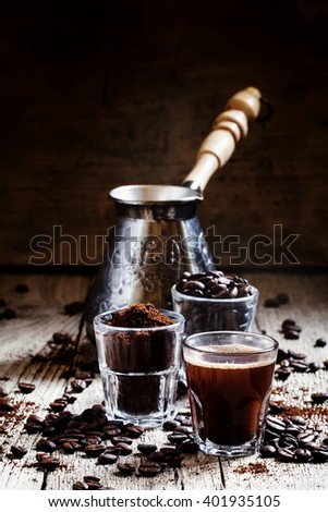 Coffee beans, ground coffee, espresso in a glass, coffee, vintage wooden background, selective focus - stock photo