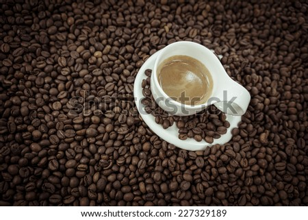Coffee beans heart isolated on wood background - stock photo