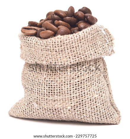 coffee beans in a burlap sack on wooden background
