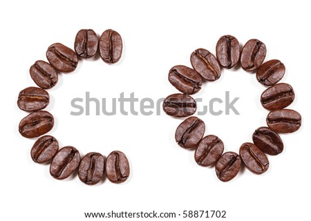 "Coffee beans in a form to spell the letter ""CO"" to be used with the other letters to spell out the word ""Coffee"" isolated on white - stock photo"