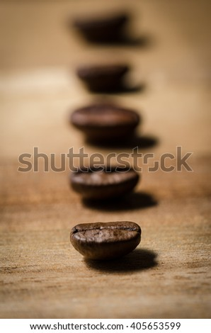 Coffee beans in a line - stock photo