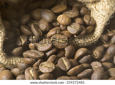 Coffee beans in a sack bag - stock photo