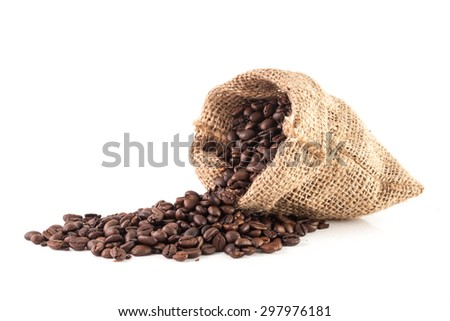 Coffee beans in a sack isolated on white, pouring coffee beans - stock photo