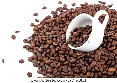 Coffee beans in a white cup isolated on white background. - stock photo