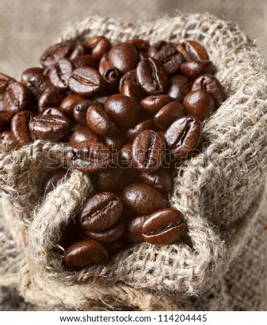 coffee beans in burlap bag - stock photo